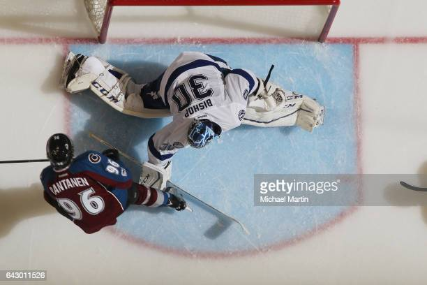 Goaltender Ben Bishop of the Tampa Bay Lightning attempts to make a save against Mikko Rantanen of the Colorado Avalanche at the Pepsi Center on...