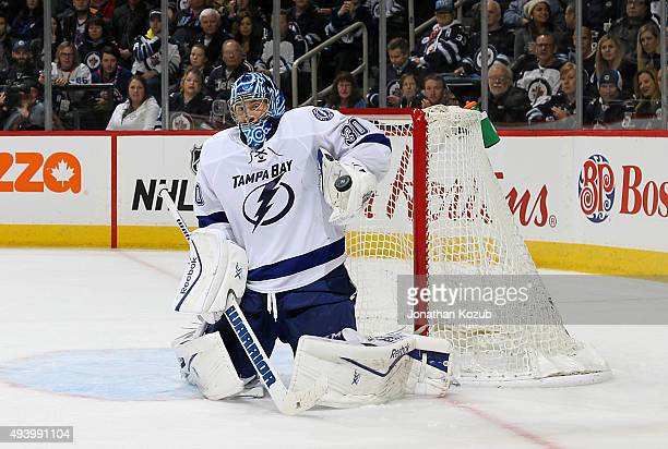 Goaltender Ben Bishop of the Tampa Bay Lightning makes a glove save during third period action against the Winnipeg Jets at the MTS Centre on October...