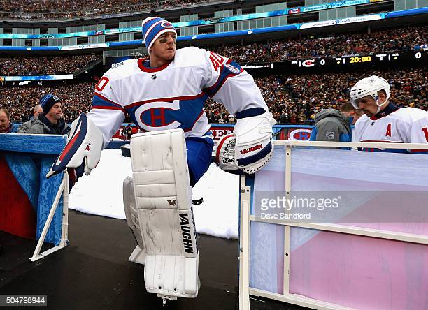 Goaltender Ben Scrivens of the Montreal Canadiens leaves the ice after warm ups before playing the Boston Bruins in the 2016 Bridgestone NHL Classic...