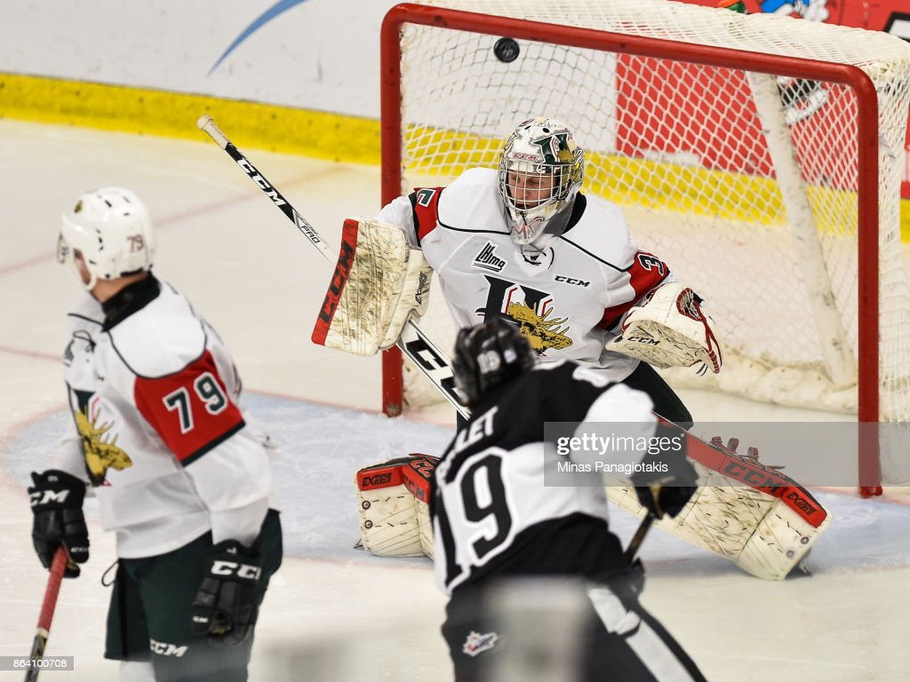 Goaltender Blade Mann-Dixon #35 of the Halifax Mooseheads redirects the puck against the Blainville-Boisbriand Armada during the QMJHL game at Centre d'Excellence Sports Rousseau on October 20, 2017 in Boisbriand, Quebec, Canada. The Halifax Mooseheads defeated the Blainville-Boisbriand Armada 4-2.