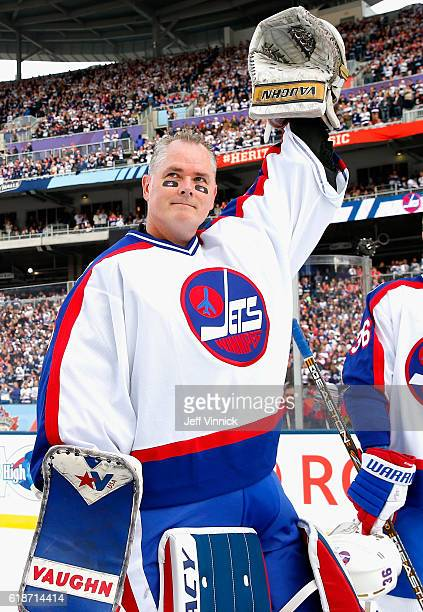 Goaltender Bob Essensa of the Winnipeg Jets alumni team acknowledges the crowd during team introductions for the 2016 Tim Hortons NHL Heritage...