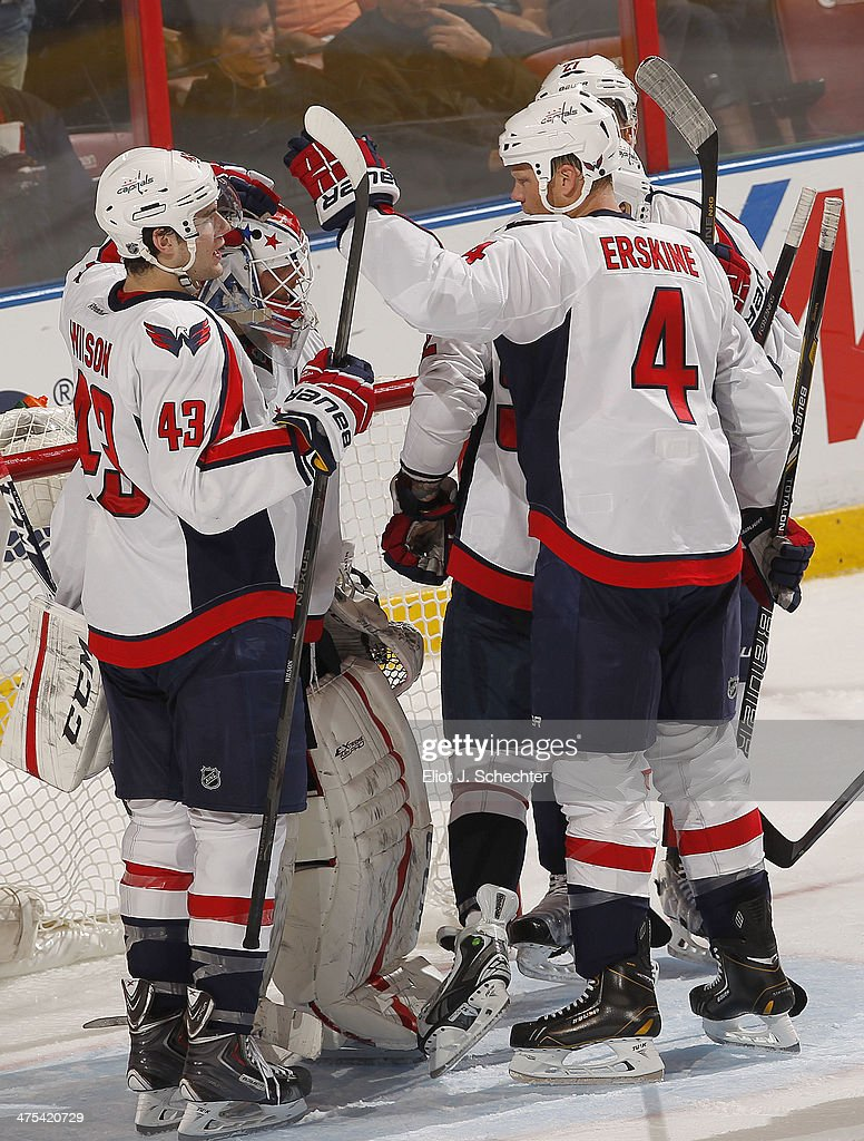 Goaltender Braden Holtby #70 of the Washington Capitals celebrates with teammates after a 5-4 win against the Florida Panthers at the BB&T Center on February 27, 2014 in Sunrise, Florida.