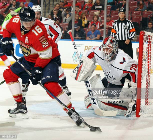 Goaltender Braden Holtby of the Washington Capitals defends the net against Aleksander Barkov of the Florida Panthers at the BBT Center on January 25...