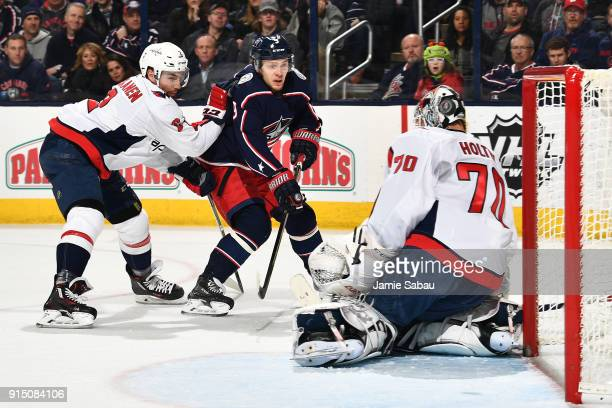 Goaltender Braden Holtby of the Washington Capitals deflects a shot taken by Artemi Panarin of the Columbus Blue Jackets during the first period of a...