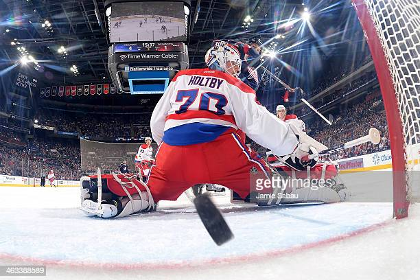 Goaltender Braden Holtby of the Washington Capitals fails to stop a shot taken by Cam Atkinson of the Columbus Blue Jackets during the third period...