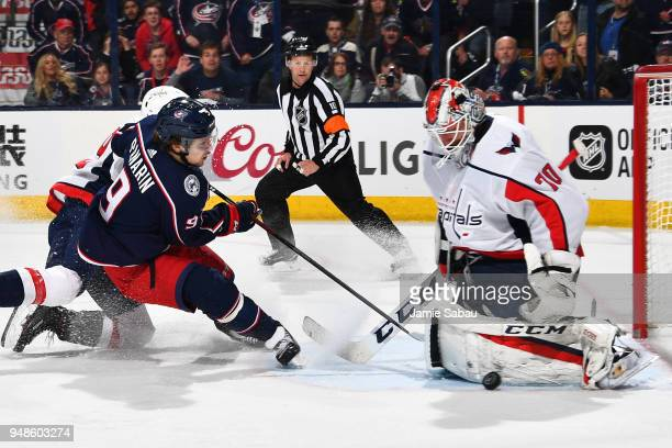 Goaltender Braden Holtby of the Washington Capitals makes a save on a shot from Artemi Panarin of the Columbus Blue Jackets in Game Three of the...