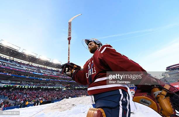 Goaltender Braden Holtby of the Washington Capitals raises his stick in the air to acknowledge the fans after the 2015 Bridgestone NHL Winter Classic...
