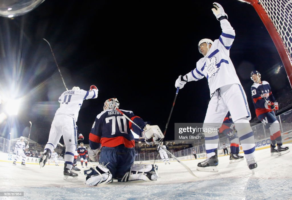 Goaltender Braden Holtby #70 of the Washington Capitals reacts as Zach Hyman #11 of the Toronto Maple Leafs celebrates after his goal with teammate Matt Martin #15 during the first period of the 2018 Coors Light NHL Stadium Series game against the Toronto Maple Leafs at the Navy-Marine Corps Memorial Stadiumon March 3, 2018 in Annapolis, Maryland.