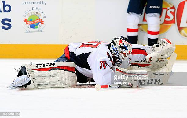 Goaltender Braden Holtby of the Washington Capitals stretches during the pregame warm up prior to NHL action against the Winnipeg Jets at the MTS...