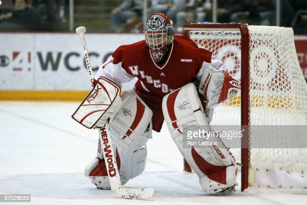 Goaltender Brian Elliot of the University of Wisconsin Badgers eyes the play from the crease against the Minnesota Golden Gophers on December 3 2005...