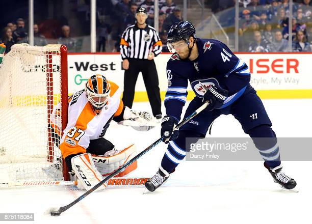 Goaltender Brian Elliott of the Philadelphia Flyers guards the net as Joel Armia of the Winnipeg Jets plays the puck during first period action at...