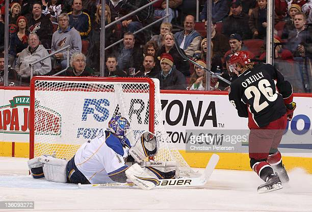 Goaltender Brian Elliott of the St Louis Blues makes a save on the shot from Cal O'Reilly of the Phoenix Coyotes during the NHL game at Jobingcom...
