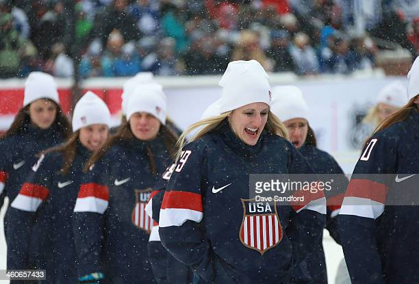 Goaltender Brianne McLaughlin of the US Women's National Team and her teammates walk off the field in between the second and third period during the...