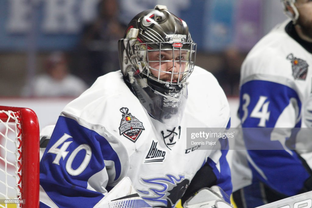 Goaltender Callum Booth #40 of the Saint John Sea Dogs watches the play in a game against the Windsor Spitfires on May 19, 2017 during Game 1 of the Mastercard Memorial Cup at the WFCU Centre in Windsor, Ontario, Canada.