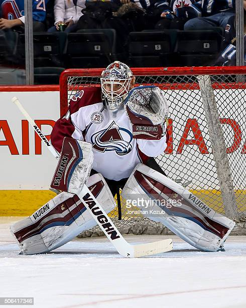 Goaltender Calvin Packard of the Colorado Avalanche takes part in the pregame warm up prior to NHL action against the Winnipeg Jets at the MTS Centre...