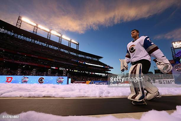 Goaltender Calvin Pickard of the Colorado Avalanche walks back to the locker room after warmup prior to the 2016 Coors Light Stadium Series game...