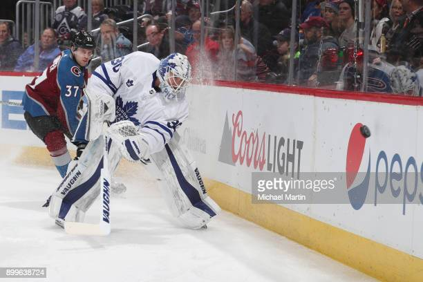 Goaltender Calvin Pickard of the Toronto Maple Leafs clears the puck infront of JT Compher of the Colorado Avalanche at the Pepsi Center on December...