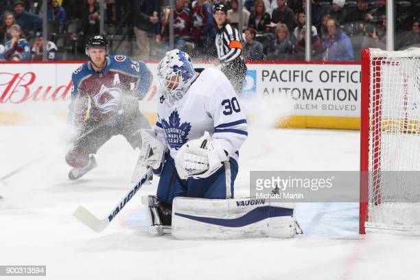 Goaltender Calvin Pickard of the Toronto Maple Leafs makes a save against Nathan MacKinnon of the Colorado Avalanche at the Pepsi Center on December...