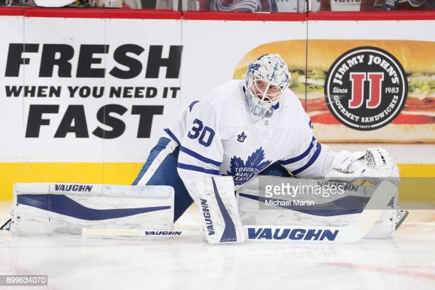 Goaltender Calvin Pickard of the Toronto Maple Leafs stretches during warm ups prior to the game against the Colorado Avalanche at the Pepsi Center...