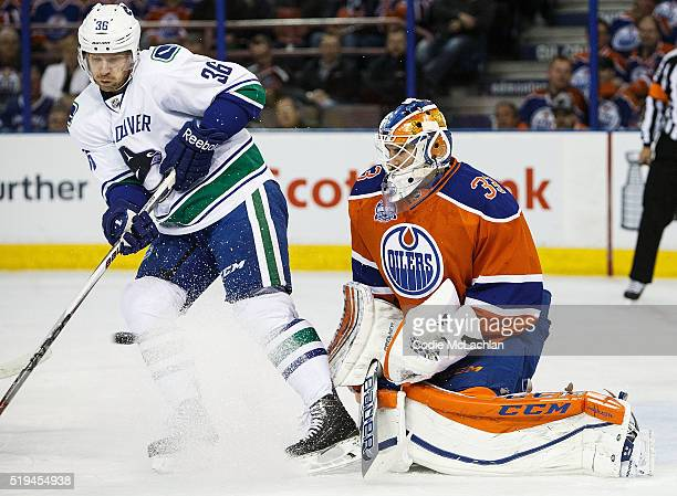 Goaltender Cam Talbot of the Edmonton Oilers defends the net against Jannik Hansen of the Vancouver Canucks on April 6 2016 at Rexall Place in...