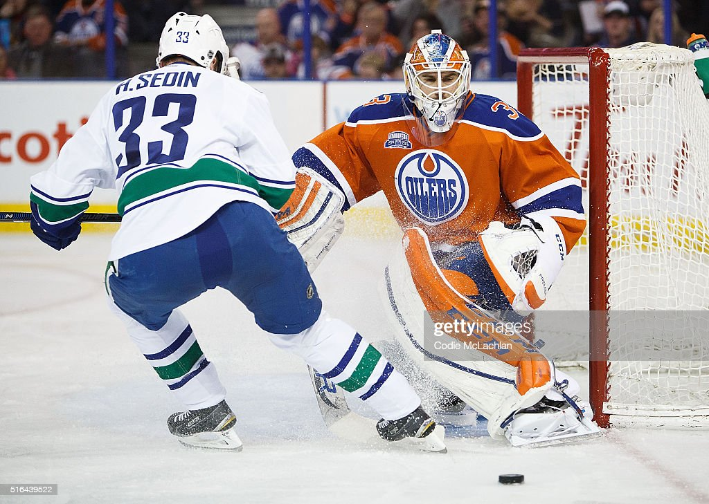 Goaltender Cam Talbot #33 of the Edmonton Oilers makes a save against Henrik Sedin #33 of the Vancouver Canucks on March 18, 2016 at Rexall Place in Edmonton, Alberta, Canada.