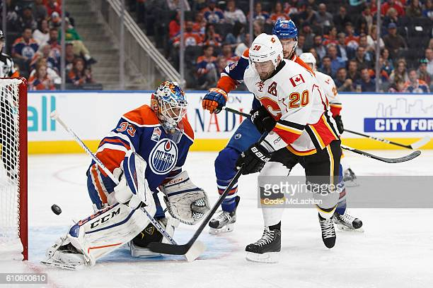Goaltender Cam Talbot of the Edmonton Oilers makes a save against against Chris Higgins of the Calgary Flames on September 26 2016 at Rogers Place in...