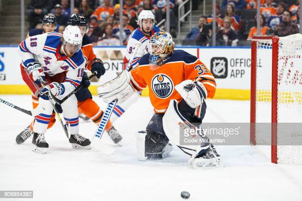 Goaltender Cam Talbot of the Edmonton Oilers makes a save against Marc Staal of the New York Rangers at Rogers Place on March 3 2018 in Edmonton...