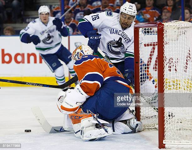 Goaltender Cam Talbot of the Edmonton Oilers makes a save on Emerson Etem of the Vancouver Canucks on April 6 2016 at Rexall Place in Edmonton...