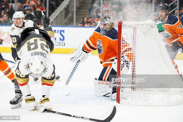 Goaltender Cam Talbot of the Edmonton Oilers shuts the door on William Carrier of the Vegas Golden Knights at Rogers Place on April 5 2018 in...
