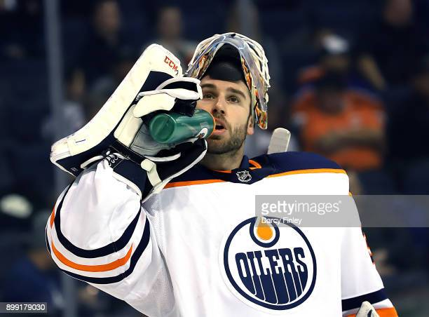 Goaltender Cam Talbot of the Edmonton Oilers stays hydrated during a second period stoppage in play against the Winnipeg Jets at the Bell MTS Place...