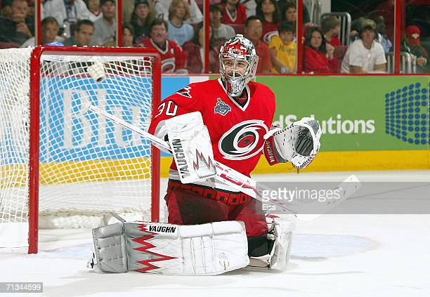 Goaltender Cam Ward of the Carolina Hurricanes drops to his leg pads to make a save against the Edmonton Oilers during game five of the 2006 NHL...