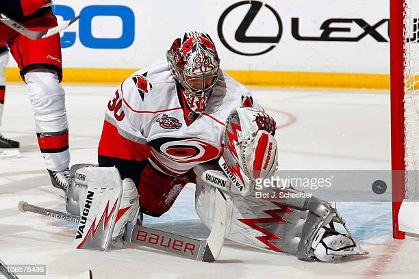 Goaltender Cam Ward of the Carolina Hurricanes fails to stop a goal by Stephen Weiss of the Florida Panthers at the BankAtlantic Center on November 5...
