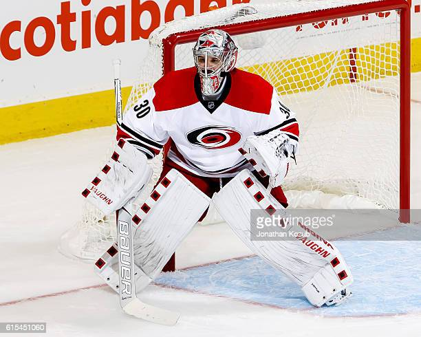 Goaltender Cam Ward of the Carolina Hurricanes guards the net during third period action against the Winnipeg Jets at the MTS Centre on October 13...