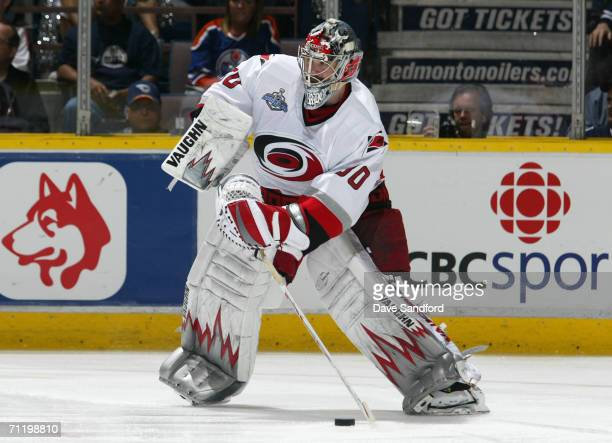 Goaltender Cam Ward of the Carolina Hurricanes plays the puck against the Edmonton Oilers during game four of the 2006 NHL Stanley Cup Finals on June...