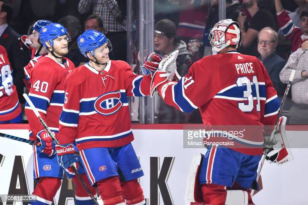 Goaltender Carey Price congratulates Jesperi Kotkaniemi of the Montreal Canadiens for his first career NHL goal against the Washington Capitals...