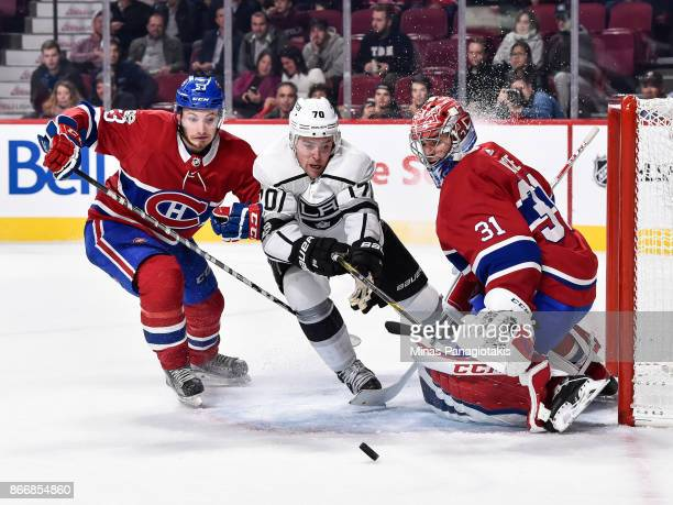 Goaltender Carey Price defends his net as Victor Mete of the Montreal Canadiens and Tanner Pearson of the Los Angeles Kings go after the puck during...