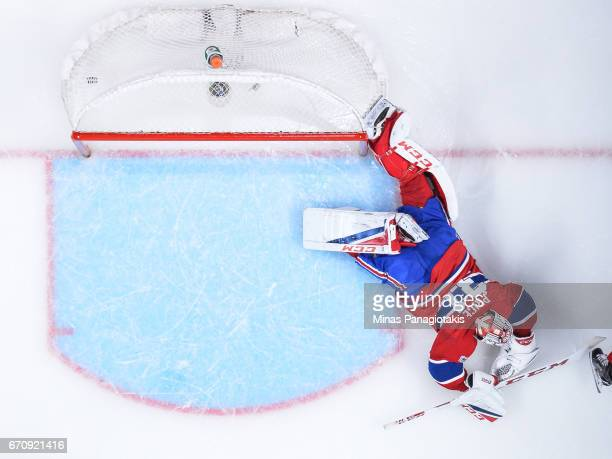 Goaltender Carey Price of the Montreal Canadiens allows a goal in overtime against the New York Rangers in Game Five of the Eastern Conference First...