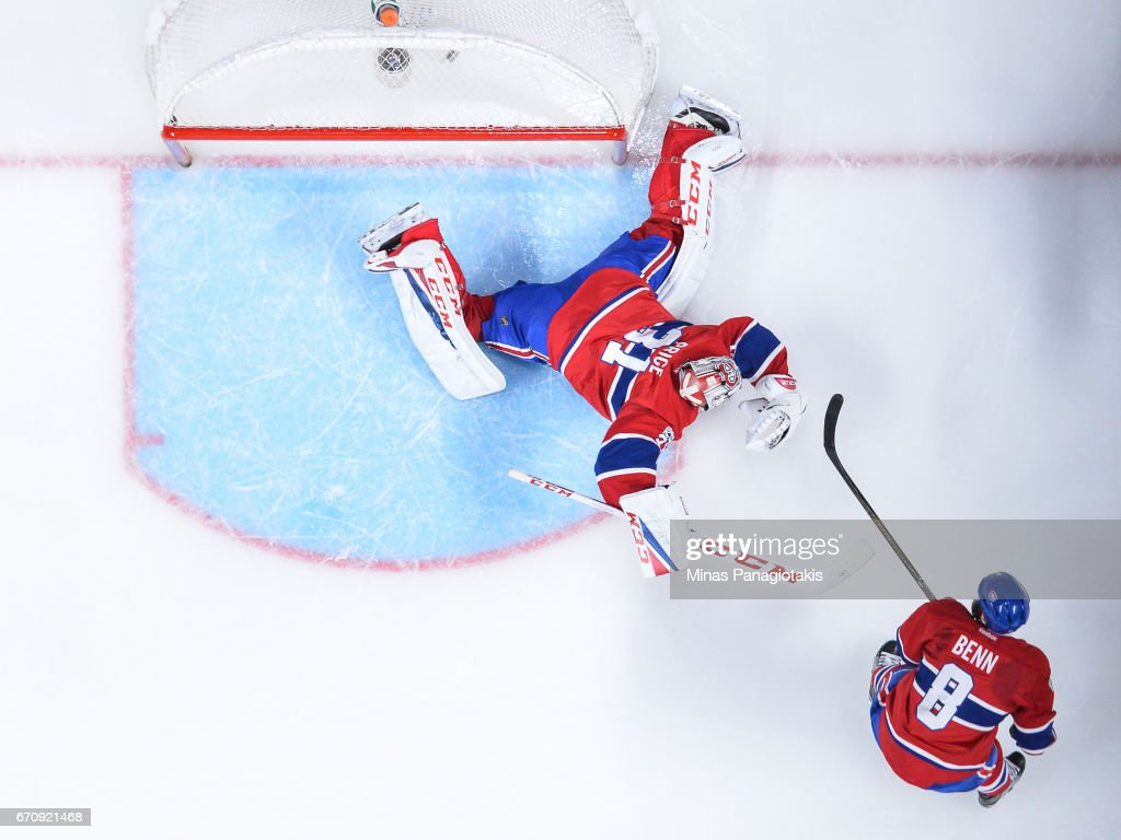 Goaltender Carey Price #31 of the Montreal Canadiens allows a goal in overtime against the New York Rangers as teammate Jordie Benn #8 watches in Game Five of the Eastern Conference First Round during the 2017 NHL Stanley Cup Playoffs at the Bell Centre on April 20, 2017 in Montreal, Quebec, Canada. The New York Rangers defeated the Montreal Canadiens 3-2 in overtime.