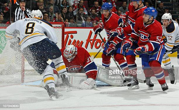 Goaltender Carey Price of the Montreal Canadiens covers the puck during the NHL game against the Buffalo Sabres on November 27 2010 at the Bell...