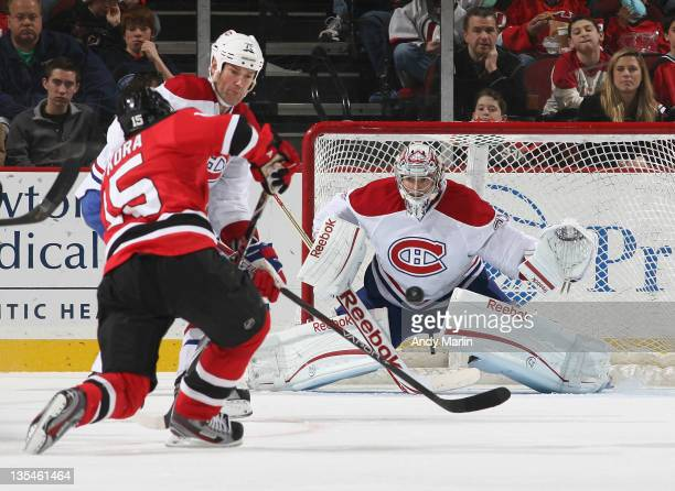 Goaltender Carey Price of the Montreal Canadiens eyes the puck on a shot by Petr Sykora of the New Jersey Devils during the game at the Prudential...