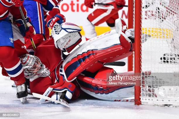 Goaltender Carey Price of the Montreal Canadiens falls to the ice as he allows a goal in the third period against the Detroit Red Wings during the...