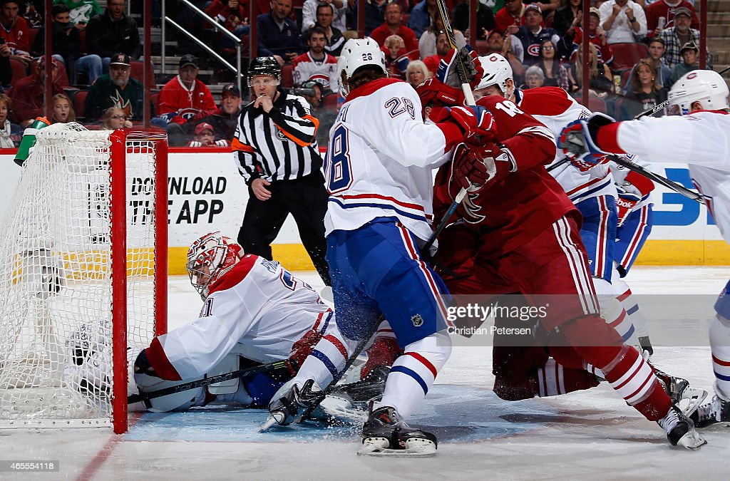Goaltender Carey Price #31 of the Montreal Canadiens holds the puck as he is pushed into the net during the third period of the NHL game against the Arizona Coyotes at Gila River Arena on March 7, 2015 in Glendale, Arizona. The Canadiens defeated the Coyotes 2-0.
