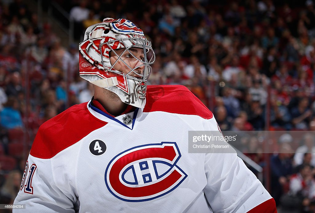 Goaltender Carey Price #31 of the Montreal Canadiens looks down ice during the third period of the NHL game against the Arizona Coyotes at Gila River Arena on March 7, 2015 in Glendale, Arizona. The Canadiens defeated the Coyotes 2-0.