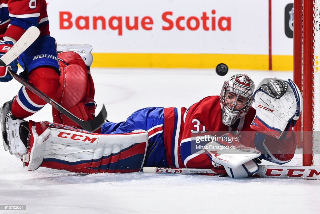 Goaltender Carey Price #31 of the Montreal Canadiens loses sight of the puck as he gets the glove up against the Nashville Predators during the NHL game at the Bell Centre on February 10, 2018 in Montreal, Quebec, Canada. The Nashville Predators defeated the Montreal Canadiens 3-2 in a shootout.