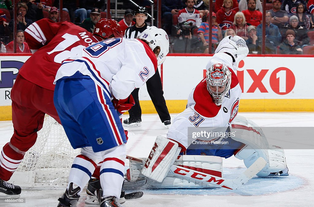 Goaltender Carey Price #31 of the Montreal Canadiens makes a pad save on the shot from the Arizona Coyotes during the third period of the NHL game at Gila River Arena on March 7, 2015 in Glendale, Arizona. The Canadiens defeated the Coyotes 2-0.