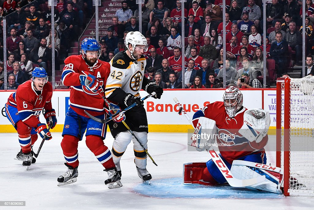 Goaltender Carey Price #31 of the Montreal Canadiens makes a stick save while teammate Andrei Markov #79 defends against David Backes #42 of the Boston Bruins during the NHL game at the Bell Centre on November 8, 2016 in Montreal, Quebec, Canada. The Montreal Canadiens defeated the Boston Bruins 3-2.
