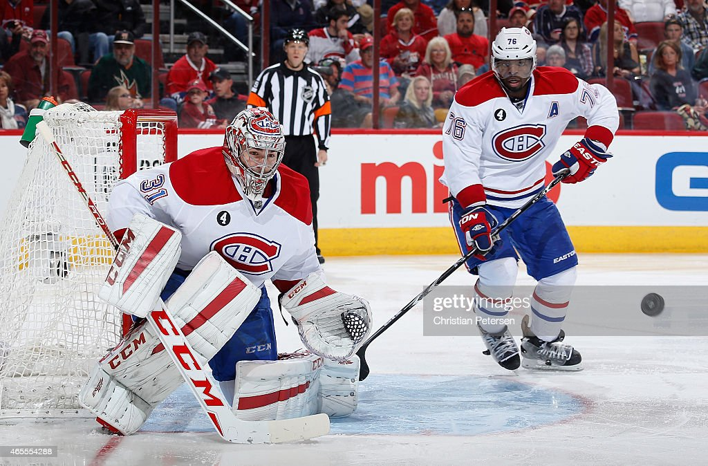 Goaltender Carey Price #31 of the Montreal Canadiens prepares to makes a save as P.K. Subban #76 skates in during the third period of the NHL game against the Arizona Coyotes at Gila River Arena on March 7, 2015 in Glendale, Arizona. The Canadiens defeated the Coyotes 2-0.