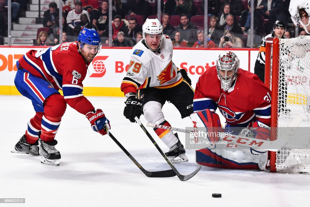 Goaltender Carey Price #31 of the Montreal Canadiens protects his net as teammate Shea Weber #6 and Micheal Ferland #79 of the Calgary Flames skate after the puck during the NHL game at the Bell Centre on December 7, 2017 in Montreal, Quebec, Canada. The Calgary Flames defeated the Montreal Canadiens 3-2 in overtime.
