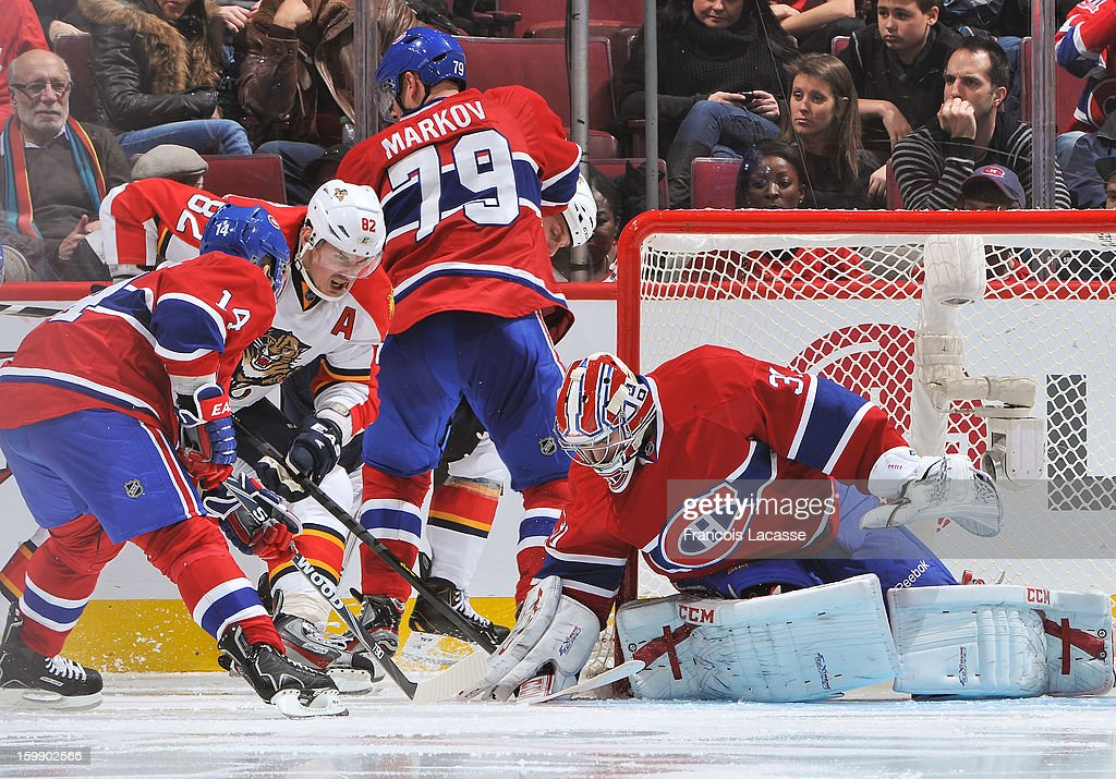 Goaltender Carey Price of the Montreal Canadiens puts his glove over the puck during the NHL game against the Florida Panthers on January 22, 2013 at the Bell Centre in Montreal, Quebec, Canada.