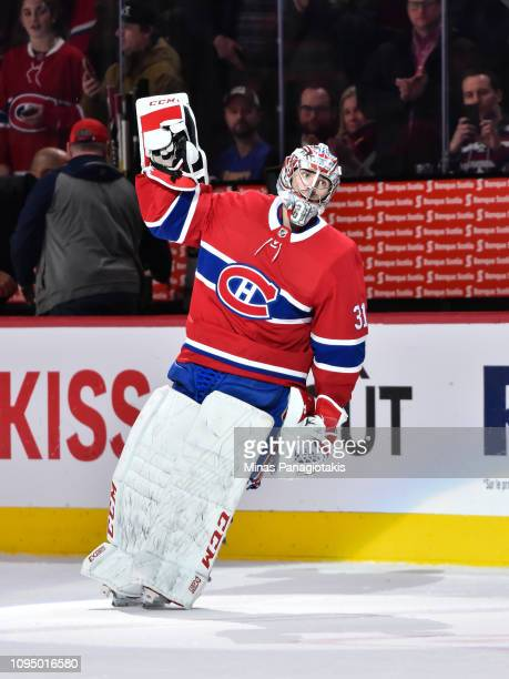 Goaltender Carey Price of the Montreal Canadiens salutes the fans after a victory against the Colorado Avalanche during the NHL game at the Bell...